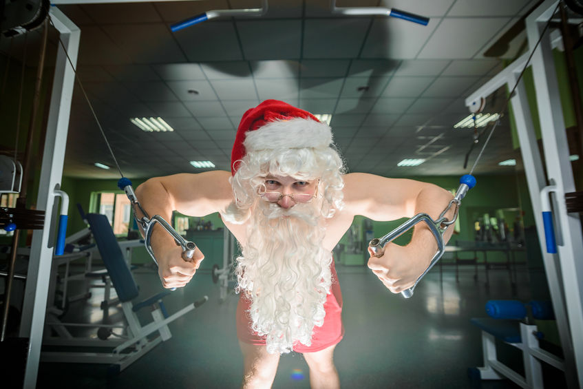 32350201 – bodybuilder santa on workout in a gym